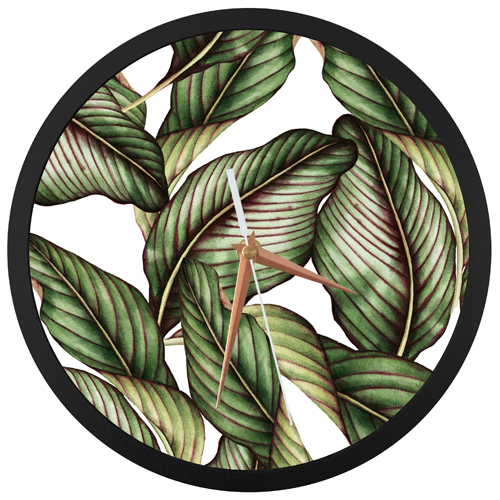 Wall clock with Tropical Leaf design face print and black ring detailing. Rose gold hands & white second hand.