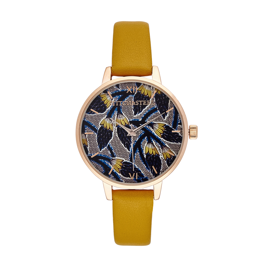 Looking for an elegant way to incorporate a subtle yet stunning pop of colour to your ensemble? Look no further than our African print pinecone inspired watch design. Known to symbolise Human enlightenment, you will definitely stand out from the crowd in this timepiece. Each one of our watches comes with a manufacturers warranty enclosed in the box, we pride ourselves in our packaging where each watch comes with a unique African Dutch Wax Print Drawstring bag which has been made by local women in South Africa as we pride ourselves to be a design company whom supports our local community.  Available in Mustard and Black strap  38mm Diameter Dials Slim face silhouette Rose Gold Plated buckle, case and dials 6&12 Roman numerals Japanese Quartz Movement Stitch&Steel branding on face and engraved underneath case  Women's African Print Wrist Watch by Stitch and Steel