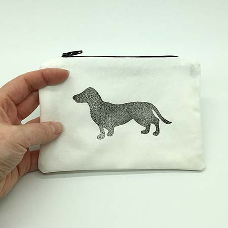 A rectangle hand block printed pouch with our very cute Woof print on the front and back. 