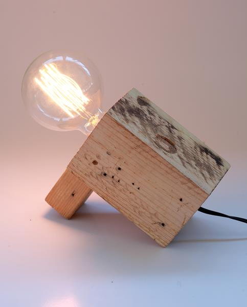 This is a simple but quirky desk lamp made with scrap wood blocks. The blocks were found on a construction site.  *Please note:As per industry standards all lighting products EXCLUDE bulbs. Also, the Lilly Loompa range of products are made to order and if a product isnot in stock, it may take +/- 10 days from date of order before you receive your special purchase.