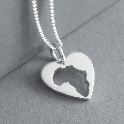 Sterling silver tiny Africa inside a heart.