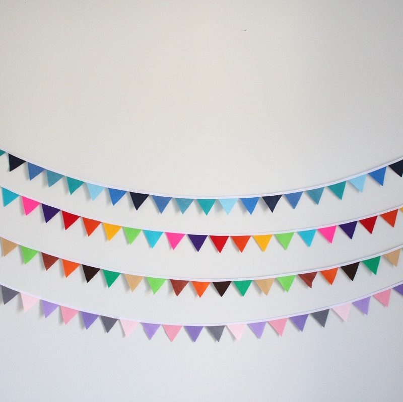 This beautiful mini felt bunting is 2.5m long and made with 45 little 3.5cm felt triangles, handcut by me.  I then machine stitch them all together with white bias-binding.  There are two little satin ribbon loops on each end to easily hang your bunting.