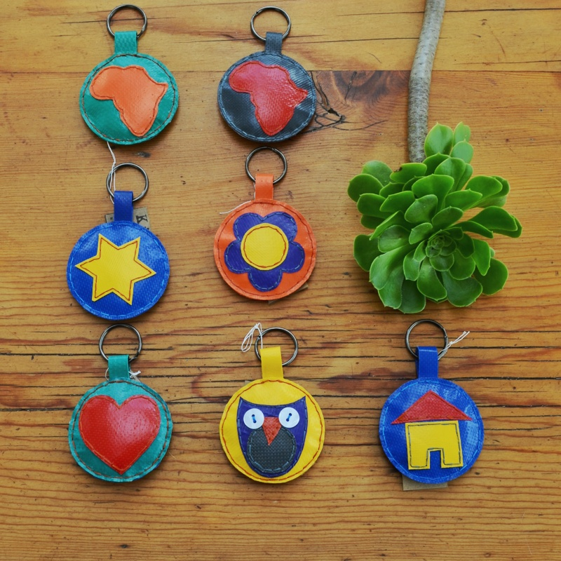 Made from old jumping castles and stuffed with discarded, single useplastic these little circles of colour will brighten up any set of keys. All items are made to order and available in all the colours and designs (hearts, flowers, owls etc.) Please note you can choose the basic colour of the item, howeverthe colours of the designs on the circles may differ to what is pictured here. Each keyring is made by hand and completely hand stitched.