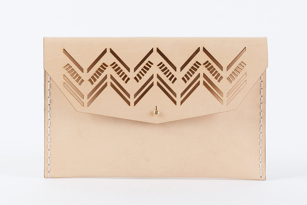 The Diagonal clutch is handcrafted using locally sourced vegetable tanned cowhide. 