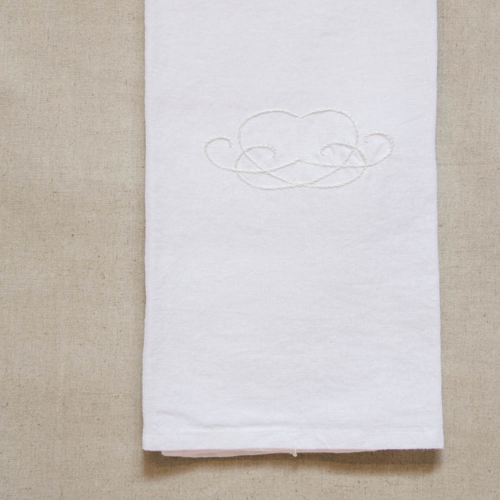 A stylish hand-embroidered linen cloth. Use this wonderfully softcloth as a tea or guest towel,to wrap warm bread, line a picnic basket, cover food before serving or simply as a beautiful display piece.  Linen, hand-embroidered heart motif inwhite on white. 54x81 cm  Handmade in South Africa.  Delivery:  Courier delivery in Cape Town within 5 business days: R50 per order Courier delivery to the rest ofSouth Africa within 5-10 business days: R65 per order