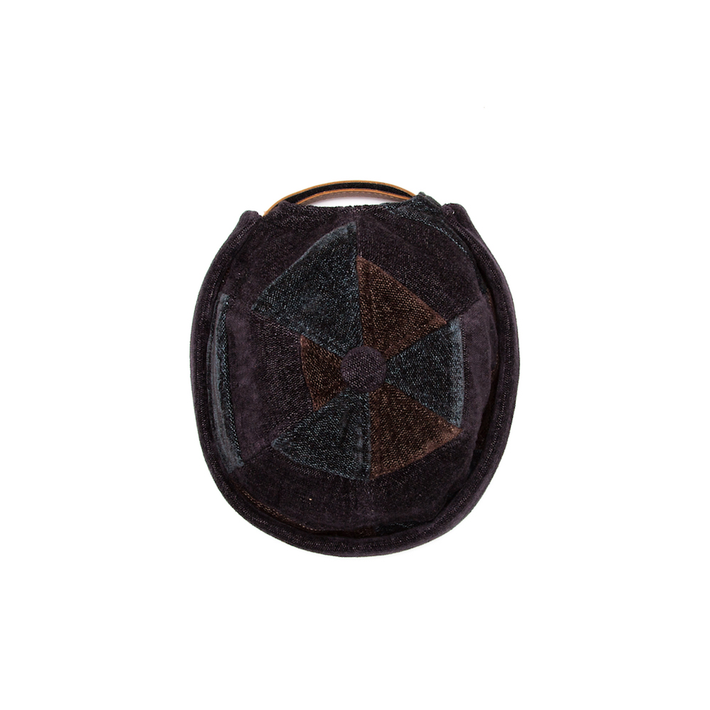 Short cap that blends the key features of a beanie and a cap. Finished with anadjustable leather backstrap.Cut from a luscious chenille/cotton throw milled bySouth African heirloom textile mill, Mungo.  Handmade in Cape Town.