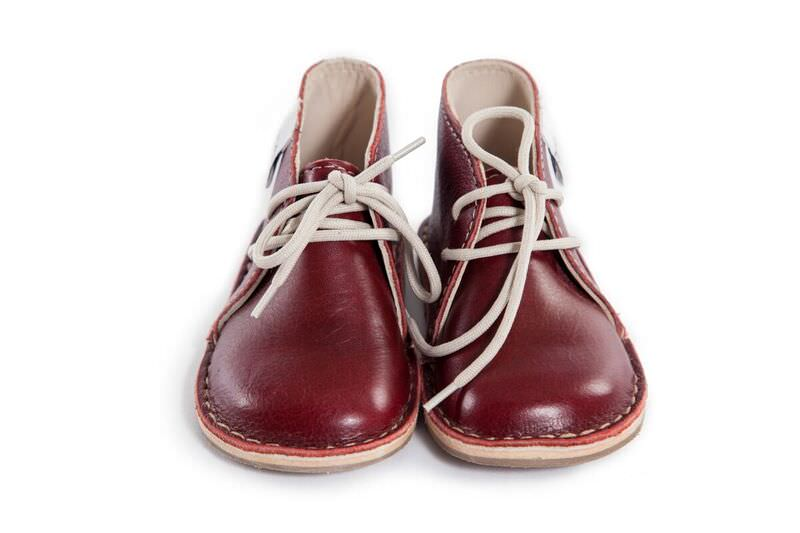 Genuine Leather oxford/vellie styled burgundy coloured shoe, with easy to tie beige laces . Waterproof and durable rubber sole.