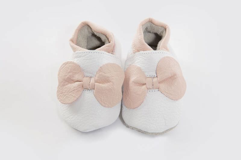 Our fabulous white leather soft sole with pink bow detail, perfect for any occasion.