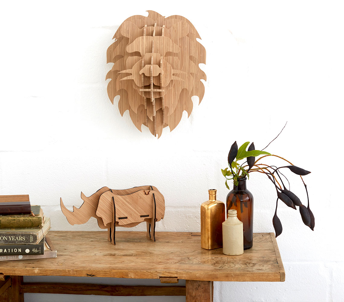 Available in BAMBOO(Med)  This regal wall-mounted lion sculpture is perfect for any interior space and easy to assemble.The sculpture is available in bamboo, nature's new wonder plant.It comes flat-packed with clear instructions on how to assemble and hang. No glue required - all you need is a nail in the wall.  For every purchase of a lion head we will donate 10% of the proceeds to the conservation of lions through Blood Lions and the Endangered Wildlife Trust. Thank you for your contribution.  Sculpture Dimensions:  MED - 45cm (H) x 35cm (W) x 34cm (D) Depth = wall to tip of nose  Weight:3.5kg (Bamboo M)  Cleaning & maintenance:  Dust with a dry or very lightly damp cloth. Keep away from high humidity and moisture such as steam. Not suitable for bathroom or outdoor installation.  Shipping:Cape Town R80, National R120,Outside of South Africa -R880  Payment Options: South Africans: Please use Payfast International customers: Please use Paypal  Ready to ship