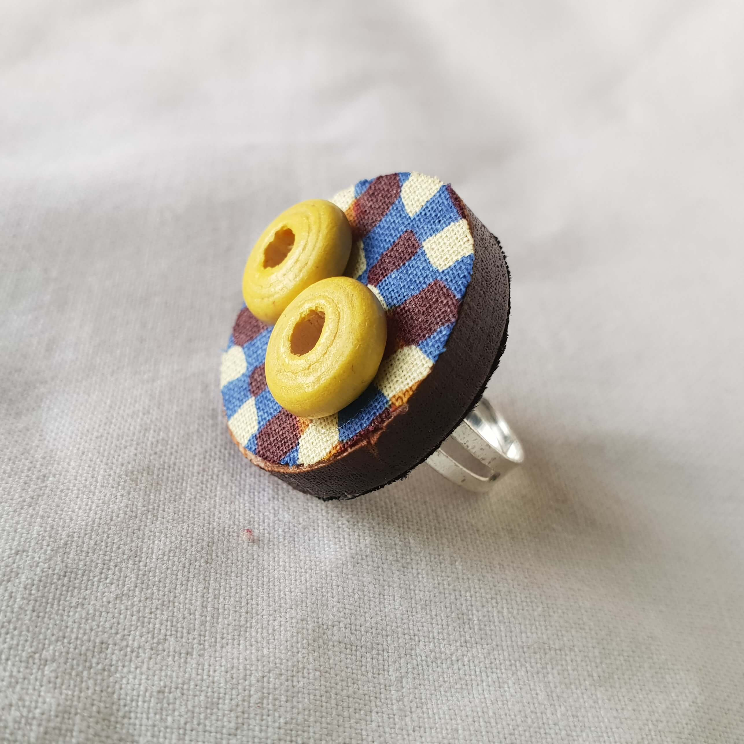 Adjustable rings made with wax print