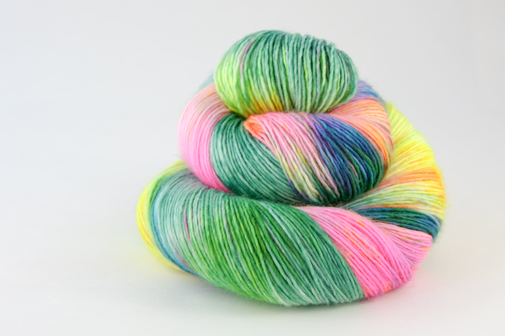 St Lucia Sock  100% fine superwash Merino, single spun  Sock/4-ply, 100g skeins, 365 metres per 100g.  Colour - Once-off colourway- variegated hot pink, neon yellow, emerald, bright blue, neon orange, bright lime  Hand wash recommended