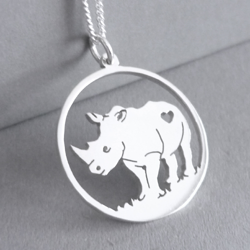 Sterling silver Rhino in circle pendant.
