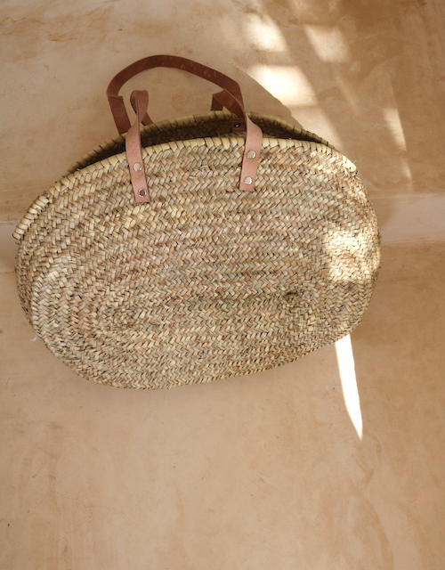 Please note that the new stock have woven handles, not leather.    Measuring 56cm x 42cm x 20cm.