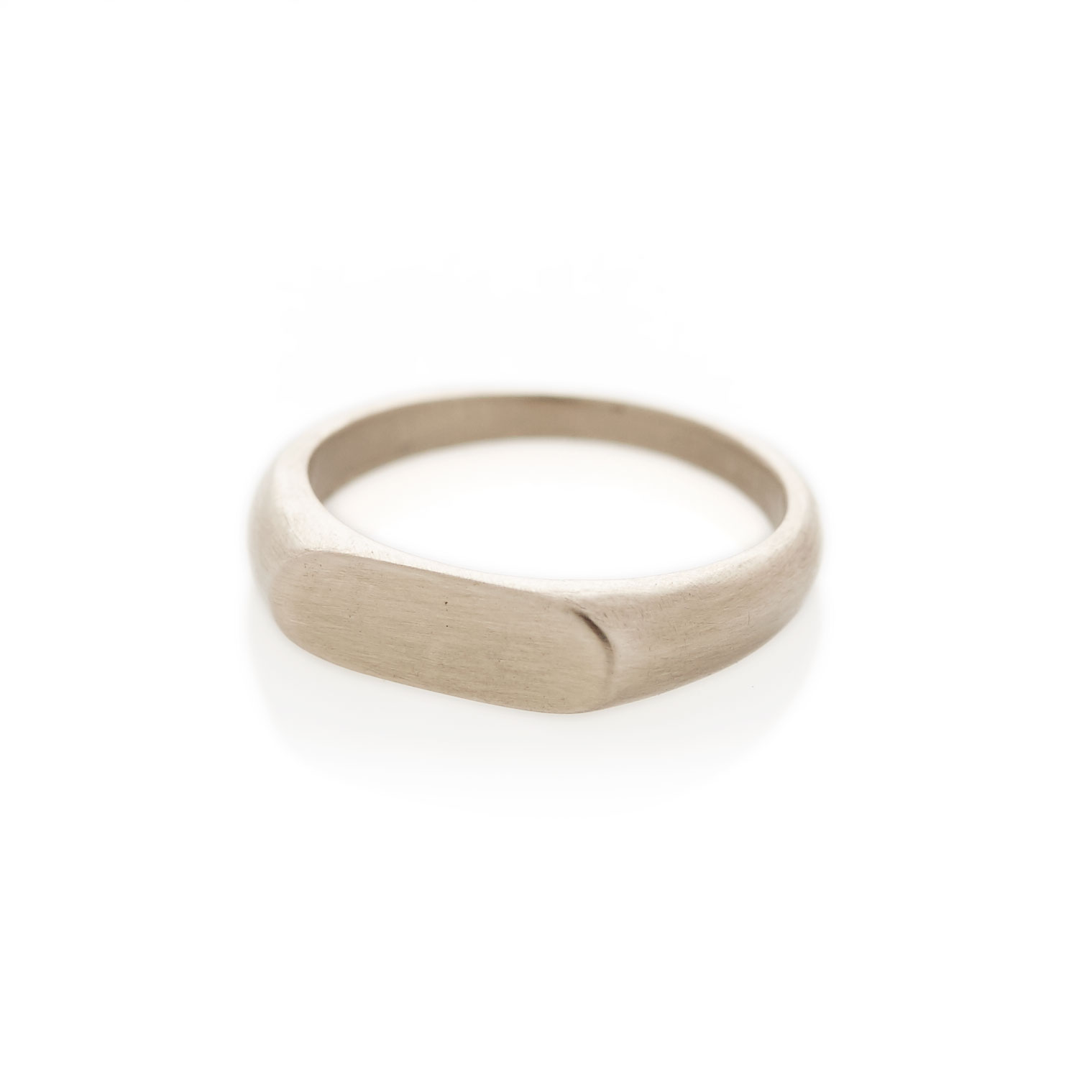A landscape oval shaped signet ring in solid 9ct white gold. The face size is approximately 5.5mm x 15mm. Available with either a brushed or polished finish.