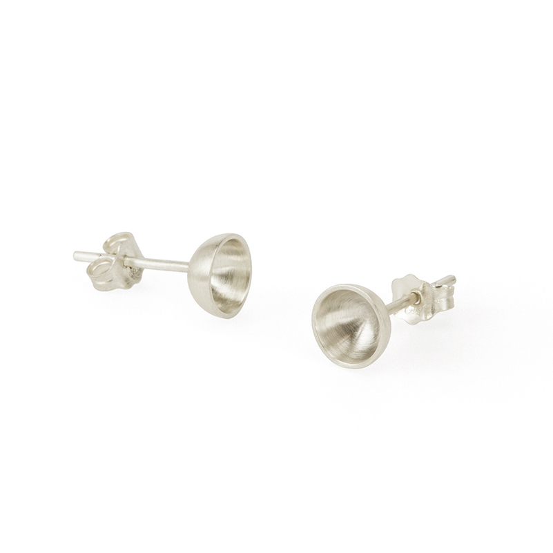 Organic cup shaped studs with a soft matte texture. The subtle shifts in the surface of the interior gives these everyday studs a pearl like sheen.  Each studs measures approximately 7mm across and is 3.6mm high (excluding post).  Handcrafted in silver reclaimed from circuit boards.