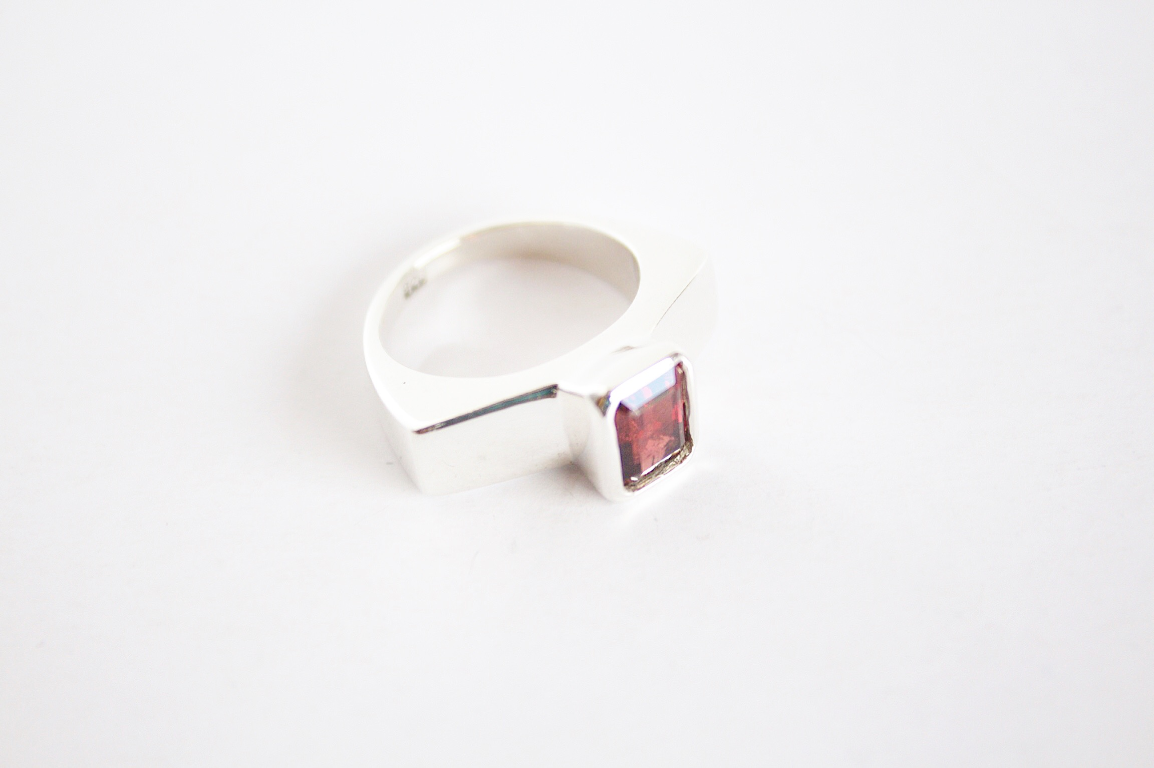 A hand carved ring set with rectangular Garnet