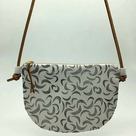 The crescent moons cross body sling is a classic handcrafted addition to your wardrobe. It features hand block printed cotton with a genuine leather adjustable strap, a gold zip and genuine leather tag.