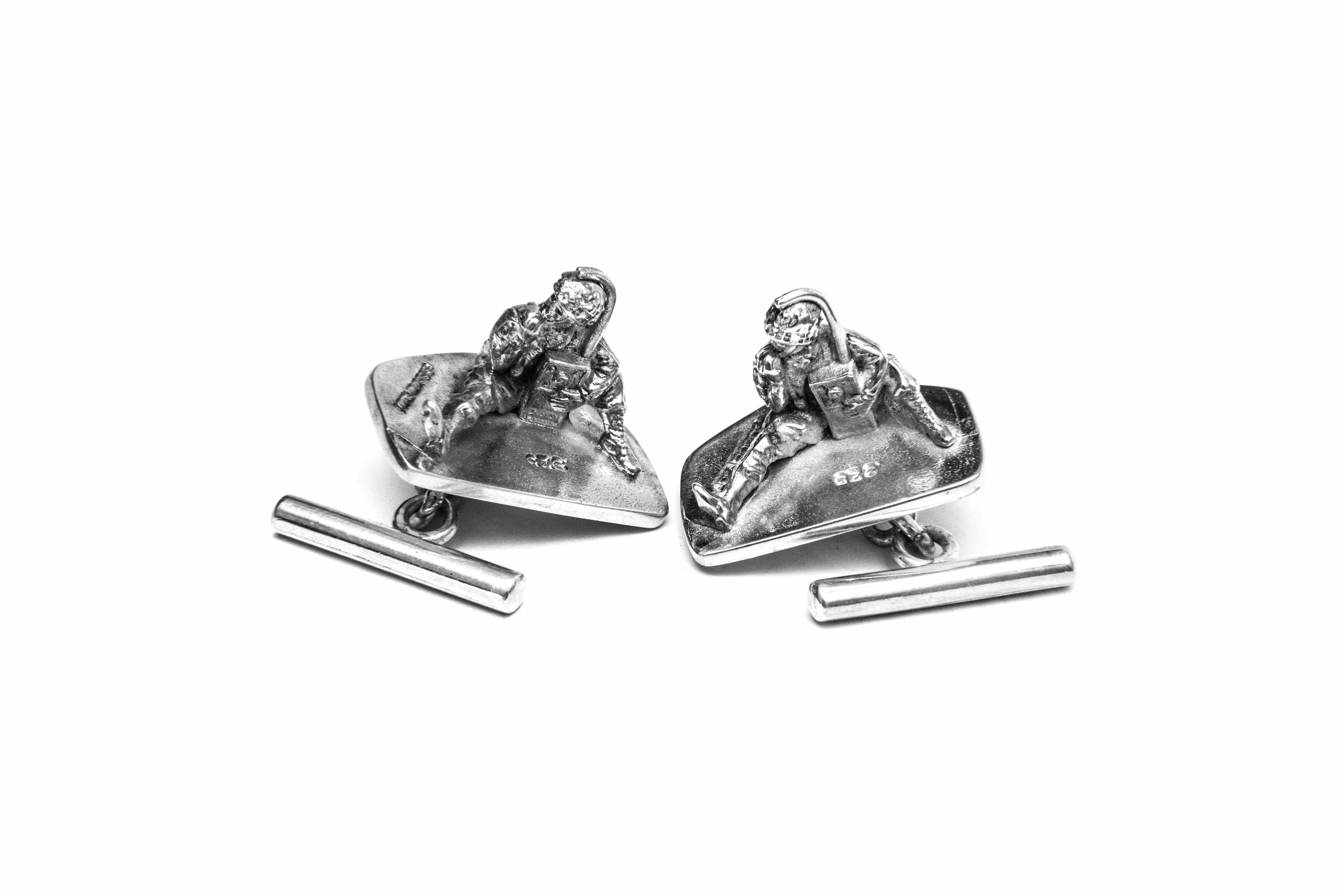 Inspired cufflinks made from miniature soldiers that appear to be listening to a radio. The Ghetto blaster cufflink set, are crafted from sterling silver.  All products supplied in hand made wooden box.