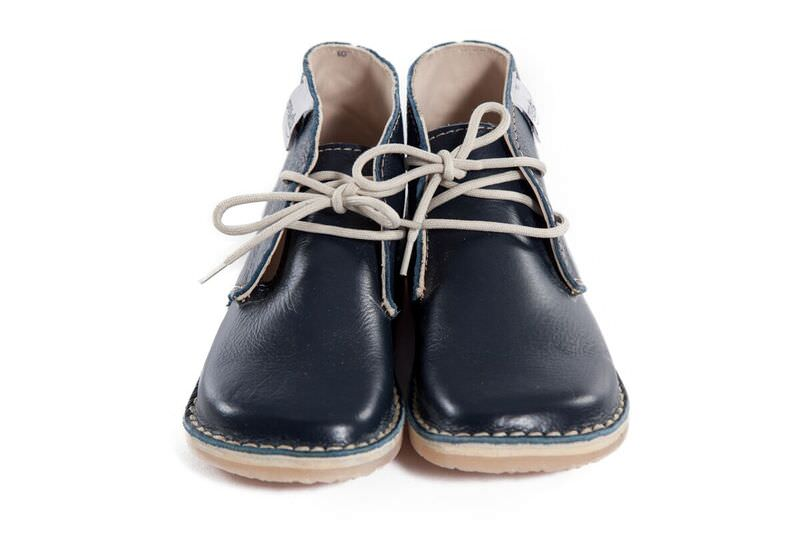 Genuine Leather oxford/vellie styled navy coloured shoe, with easy to tie beige laces for the bigger tot. Waterproof and durable rubber sole.