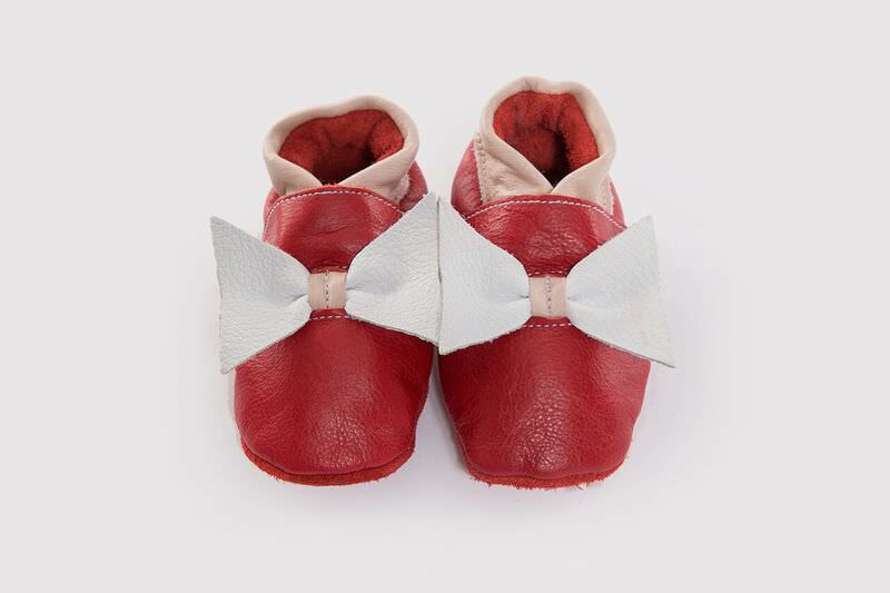 Our mouthwatering Tipsy Cherry with a cherry leather base, mink trimming and white bow. A soft sole for a little diva.