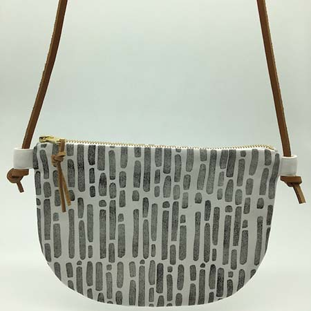 The bark cross body sling is a classic handcrafted addition to your wardrobe. It features hand block printed cotton with a genuine leather adjustable strap, a gold zip and genuine leather tag.
