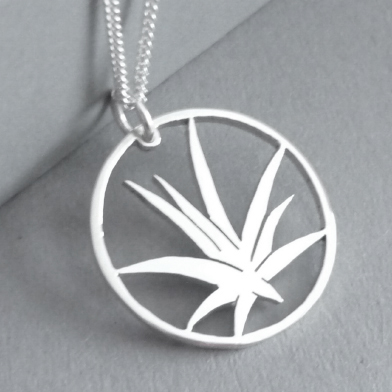 Sterling silver hand-cut Aloe in circle pendant, on 55cm chain.