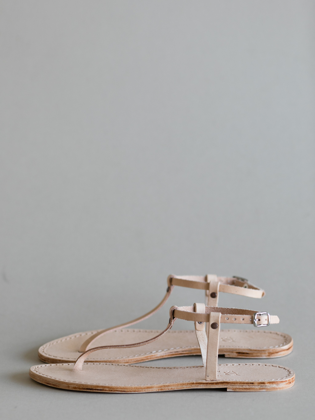 Delicate, yet diverse & just as durable as the MOJA or FUNDO, these all-leather sandals are the perfect companion to breezy summer skirts or sun drenched & sand filled beach days. The simplicity of the design called for an unadorned colour palette of vegetable tanned leather.   PLEASE NOTE —These t-bar beauties are coming soon, but are available on pre-order if you can't wait any longer.