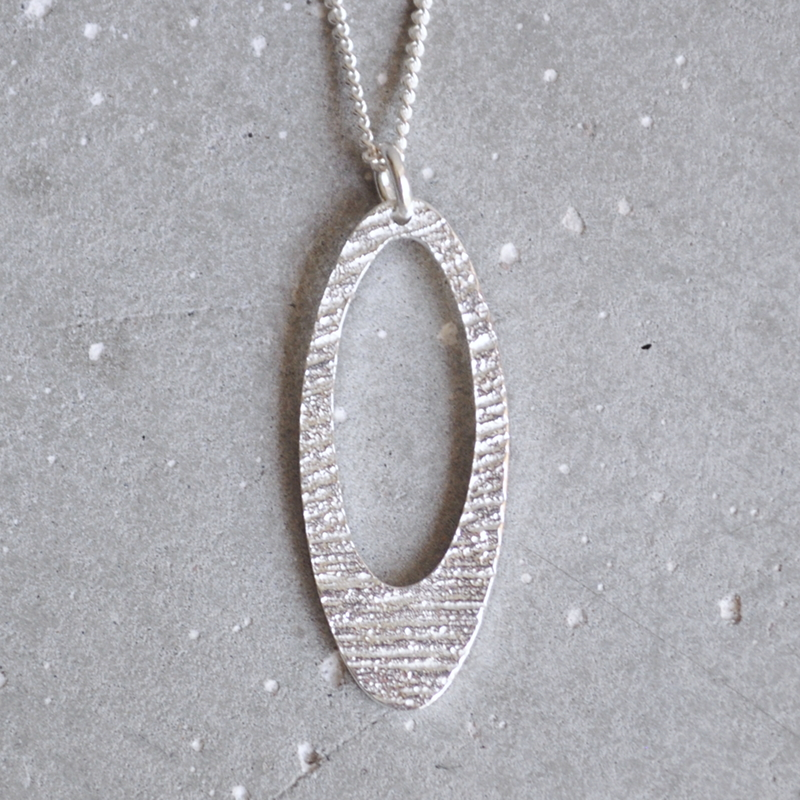 This pendant has a 25mm oval face. You can choose your chain length from the drop down menu.