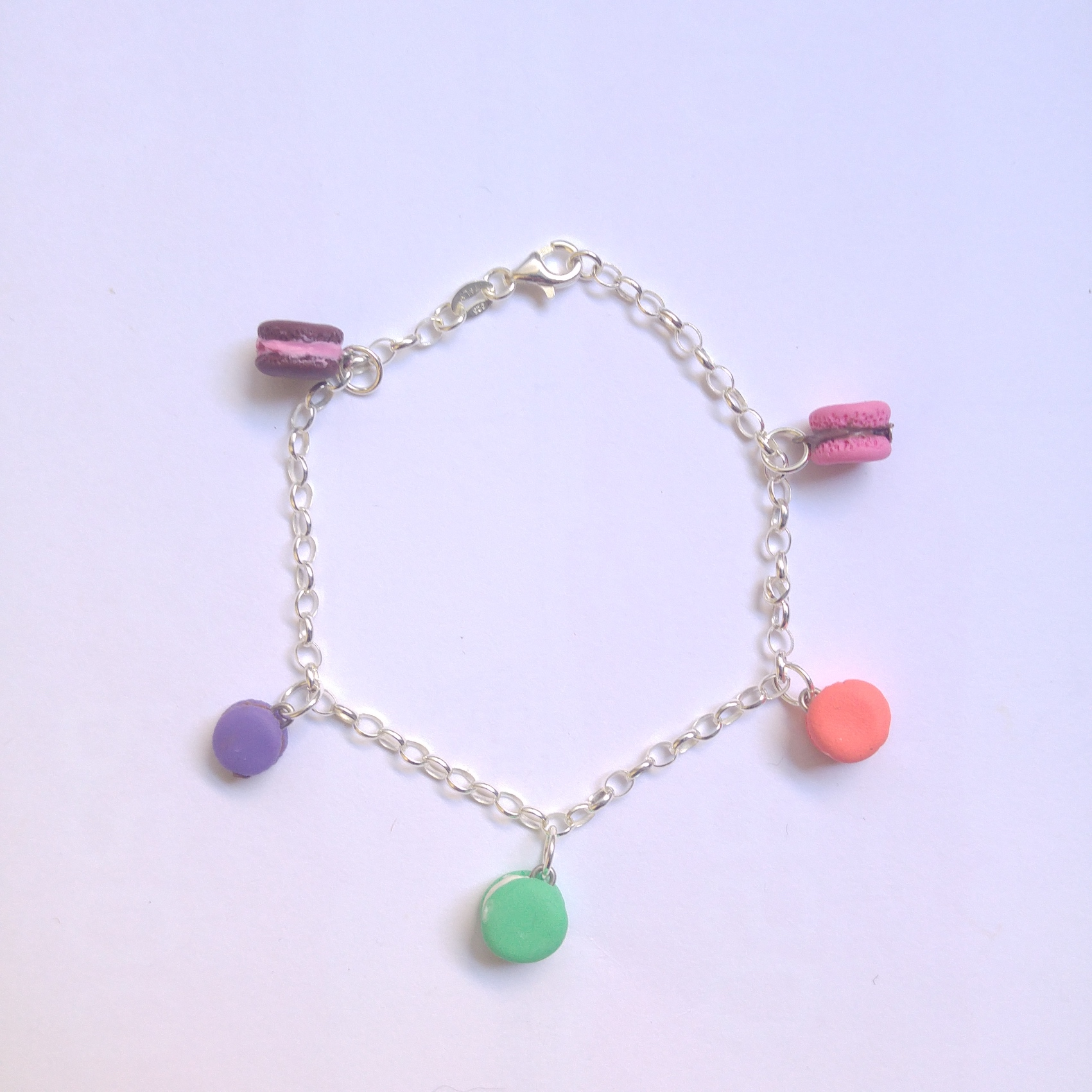 So you ADORE macarons? So do we!!  Fancy that...   Well we have made a bracelet just for you then. (and a whole range of macaron items too..)  5 flavours of macarons on a great Sterling Silver bracelet.    Charm size: +/- 1cm  Please see ourDisclaimerandFAQfor more.