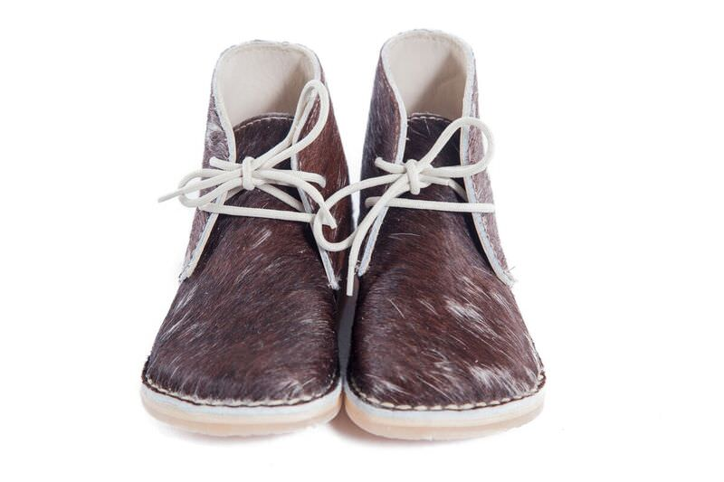 Limited edition!!Genuine Leather oxford styled nguni hide finish shoe, with easy to tie beige laces for the bigger tot. Waterproof and durable rubber sole.