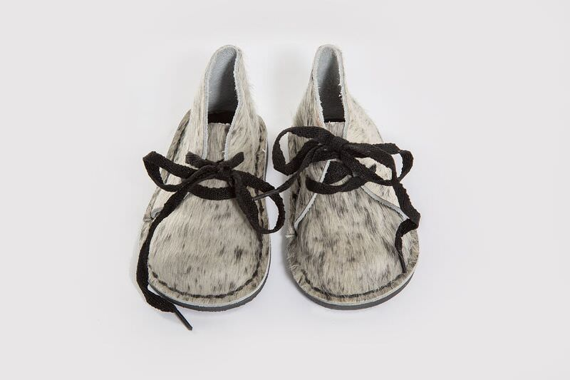 Limited edition!!Genuine Leather oxford styled nguni hide finish shoe, with easy to tie beige laces. Waterproof and durable rubber sole.