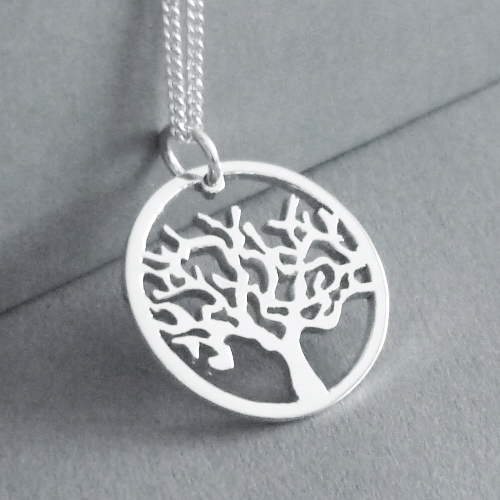 Sterling silver Tree within a circle pendant.  Cut by hand from 1.4mm thick silver, this pendant measures 21mm in diameter,you have a choice of 45cm or 50cm chains, or no chain :)