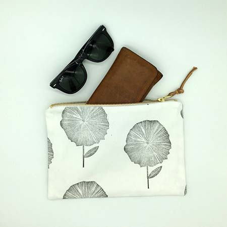 The flower clutch is a gorgeous handcrafted addition to your wardrobe. It features hand block printed cotton with a gold zip and genuine leather tag to add some sparkle and natural feel to your day or night.