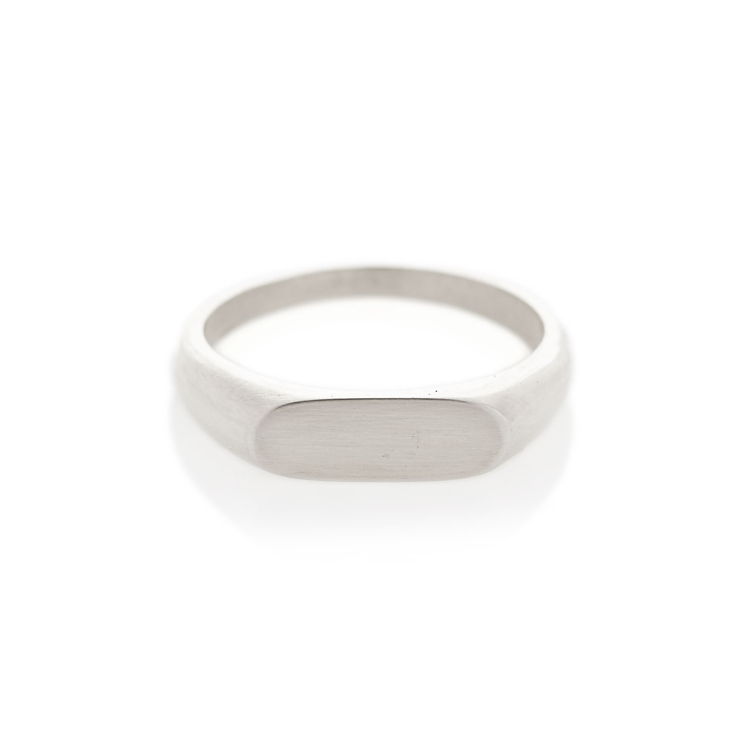 A landscape oval shaped signet ring in sterling silver. The face size is approximately 5.5mm x 15mm. Available with either a brushed or polished finish. 