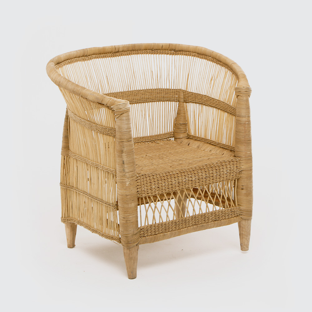 A chair fit for a king! This traditional Malawian design dates back to the 50s. Amazingly comfy, even without additional cushioning. Handwoven from durable, locally-sourced wicker. Great round the table on a covered patio, and just as at home inside as a statement piece.