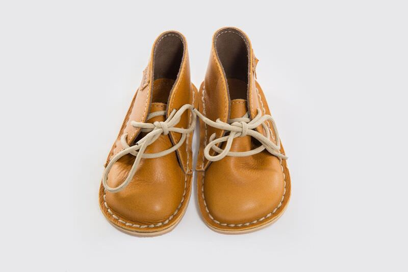 Genuine Leather oxford/vellie styled mustard coloured shoe, with easy to tie beige laces. Waterproof and durable rubber sole.