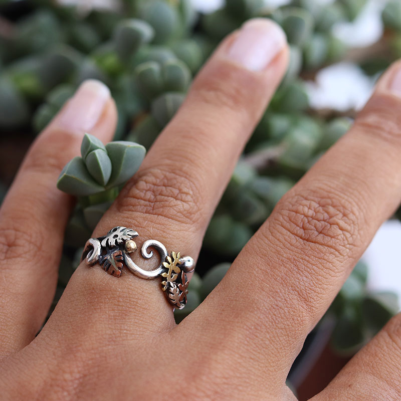 Each ring is one of a kind; the silver wire is twisted, curled and formed into a stunning band which is then adorned with brass, copper and sterling silver leaves and balls strewn all over, to create a beautiful ring worthy of the Elven Royalty. This particular listing is for this ring in size K and L (kindly note the ring size can be altered slightly by curving or uncurving the back of the ring, so please specify which size is required)