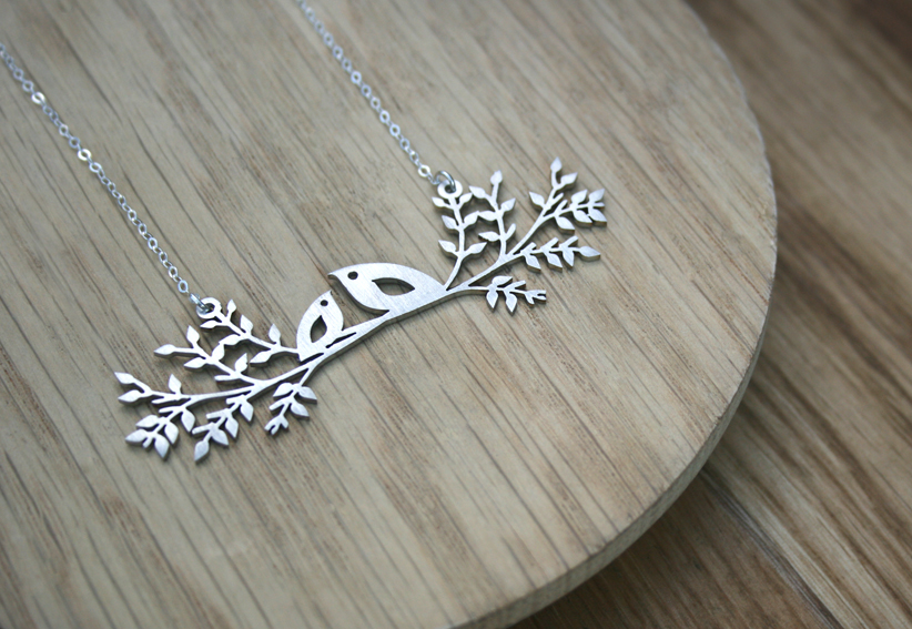 Sterling silver chain with a stainless steel pendant