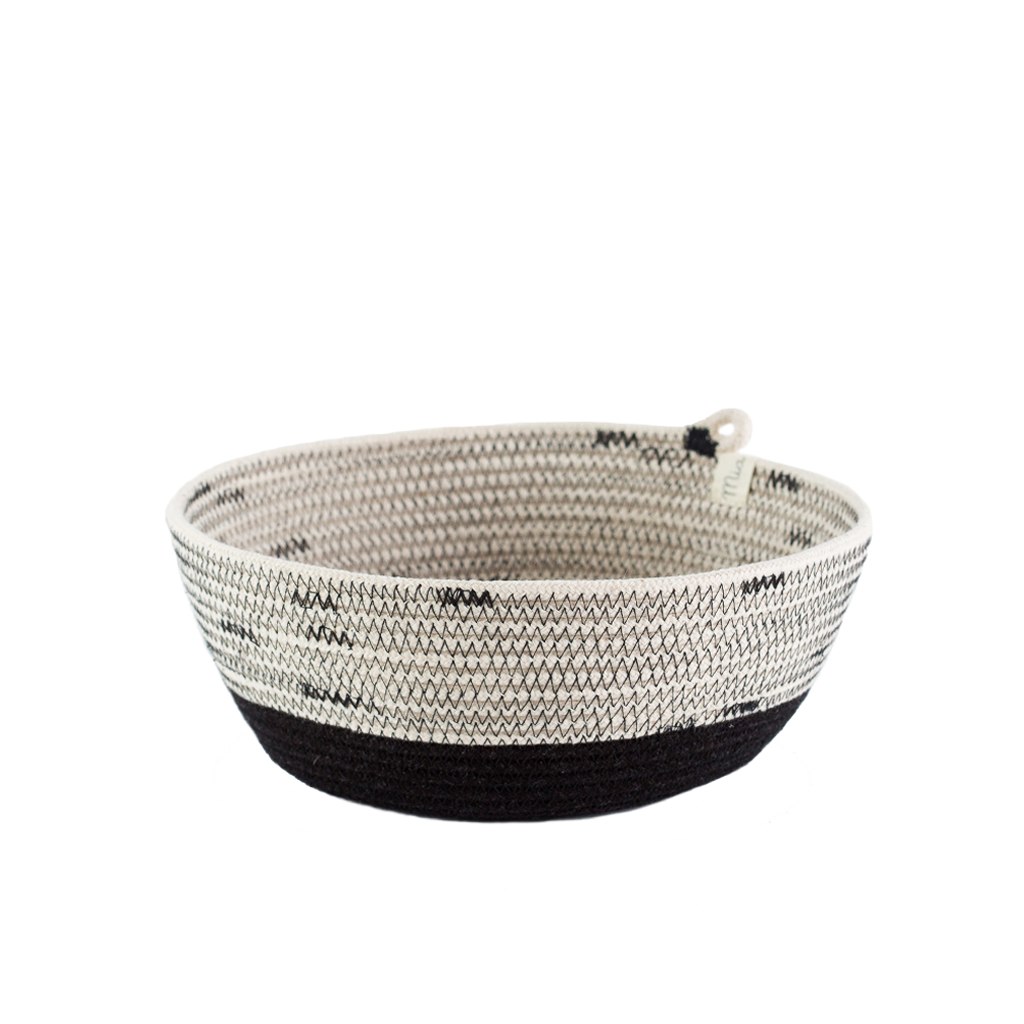 These are round baskets with a block pattern. They are available in three sizes that nestle into each other. Use them in your bathroom, as a jewelry holder, as a fruit or bread basket, or really for anything else you can think of!