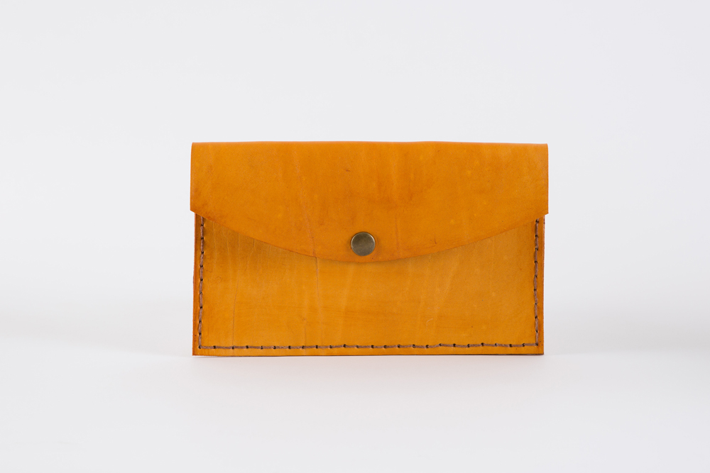 The Mini Clutch Purse is lovingly hand stitched and made to last a lifetime. Features an antique brass press stud closure. 