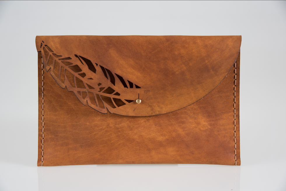 The Palm Clutch is hand crafted using locally sourced vegetable tanned cow hide. 