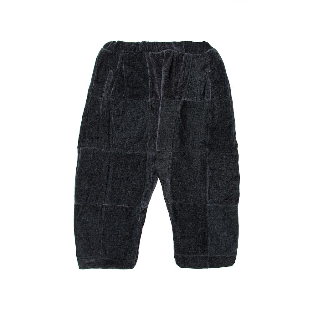 A patchwork cropped trouser, finished with deep internal side pockets and elasticated drawstring.Cut from a luscious chenille throw milled bySouth African heirloom textile mill, Mungo.  Handmade in Cape Town.