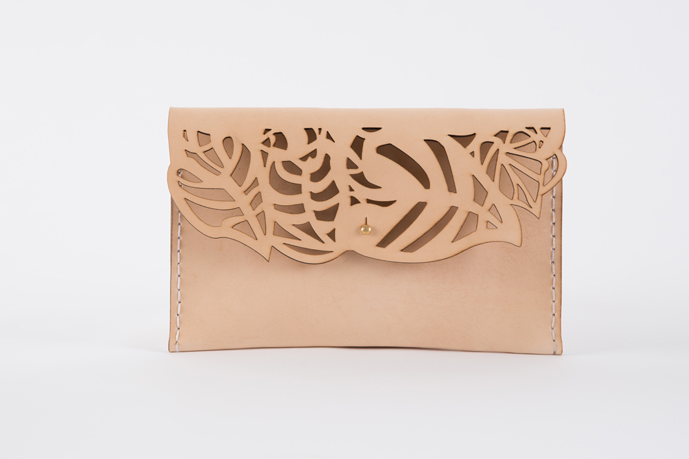 The Wilderness Clutch is hand crafted using locally sourced vegetable tanned cow hide