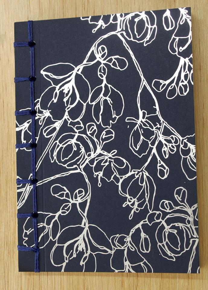A6 Handstitched notebook with silver foiled cover