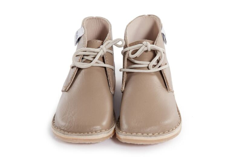 Genuine Leather oxford/vellie styled camel coloured shoe, with easy to tie beige laces for the bigger tot. Waterproof and durable rubber sole.