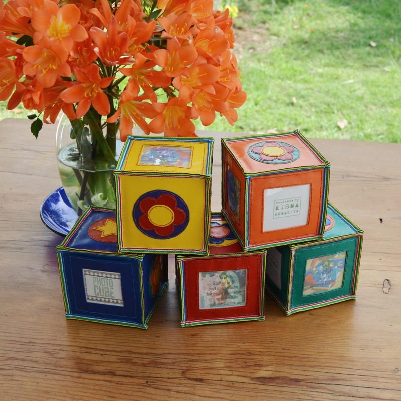 Upcycled from old jumping castles and stuffed with discarded, single usepackaging plastic. The cube has space forfour of your favourite photographs with a flower on top. The cubes are great in a set and can be piled up in a rainbow of colour and smiling faces. They will bounce so they're perfect ina home of toddlers or cats. All items are made to order and available in all the colours you see here and all designs(hearts, flowers, owls etc.) Choose the basic colour of the item. Colours of theon the circles may differ to what is pictured here.