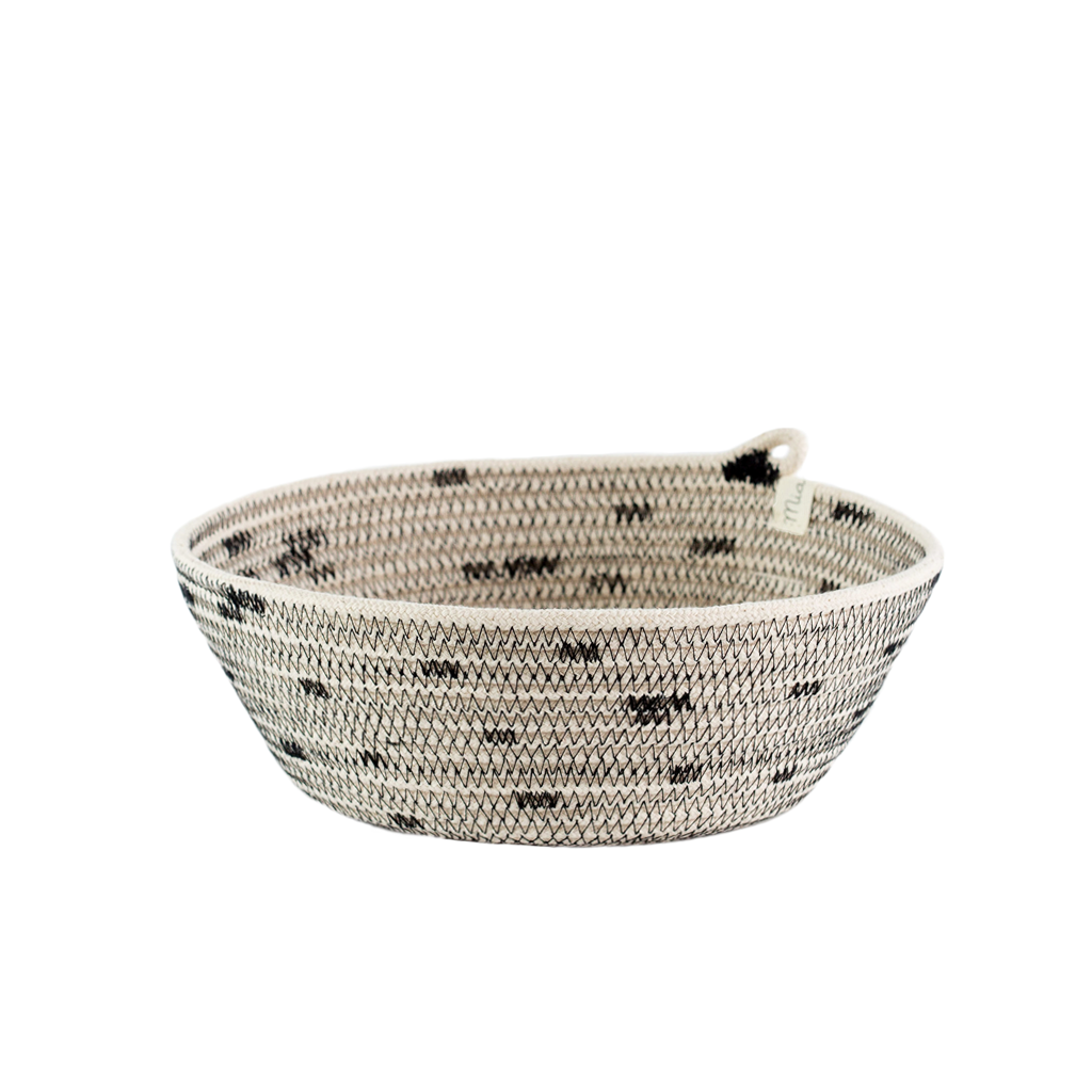 These are round baskets with a polka-dot like pattern. They are available in three sizes that nestle into each other. Use them in your bathroom, as a jewelry holder, as a fruit or bread basket, or really for anything else you can think of!