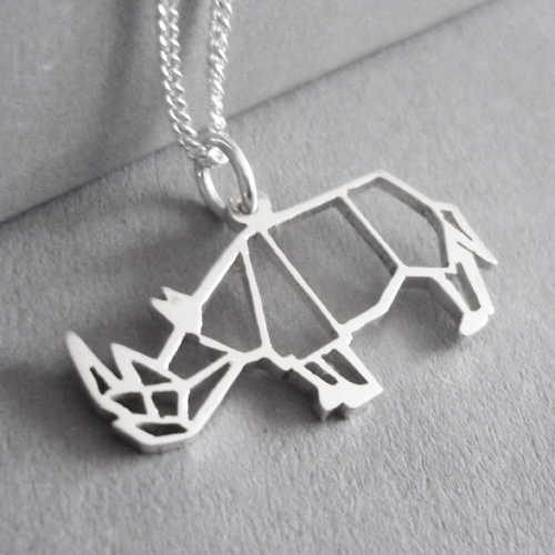 Cute little hand-cut sterling silver rhino pendant - inspired by origami design..