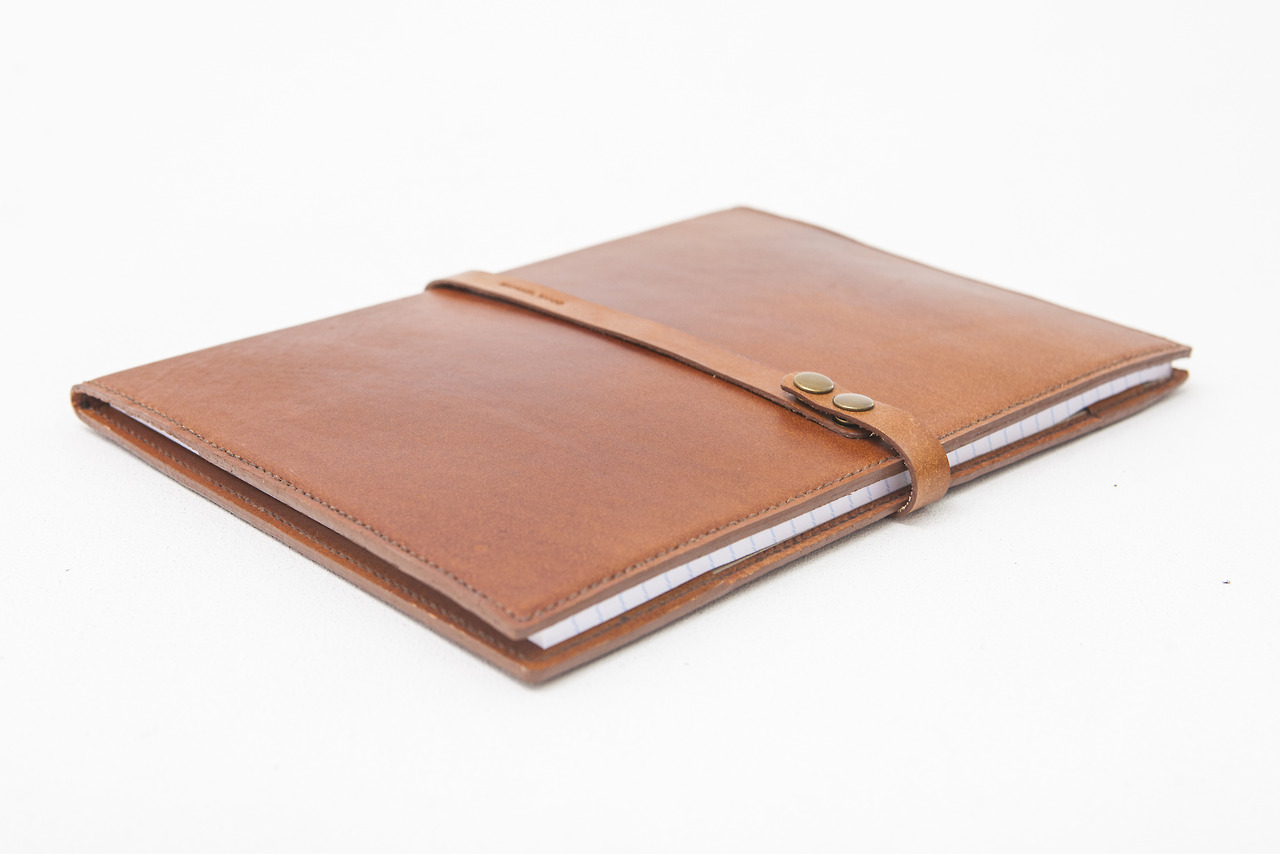 A4 Portfolio cover in calf skin veg tan leather and lined with pigsplit. A4 size, portrait, left hand hinge. Custom sizes and configurations available on request.