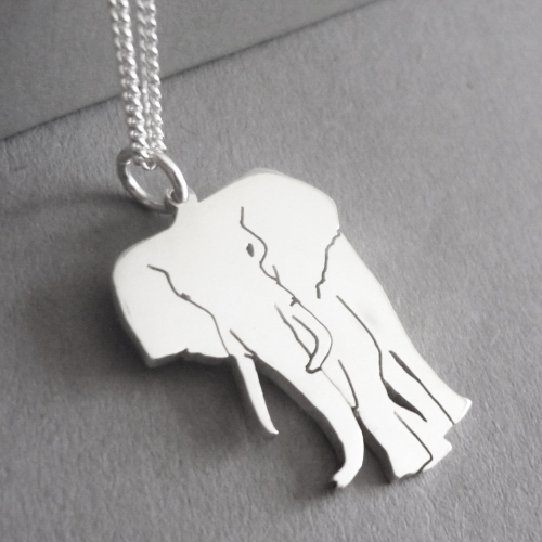 Sterling silver hand-cut elephant pendant.